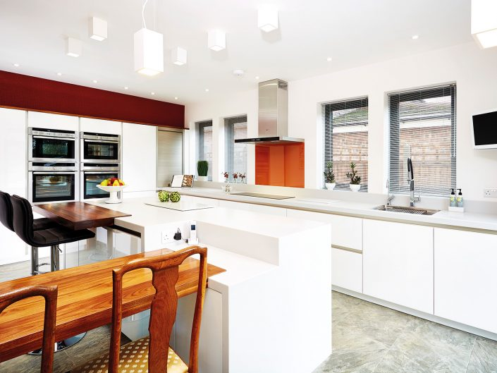 Architectural White Kitchen with Orange Splashback