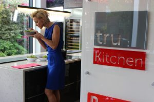 Natalie Lowe creating recipes for TV show in truKitchen Wilmslow showroom
